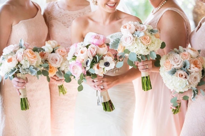bride and her bridesmaids holding their flower bouquets