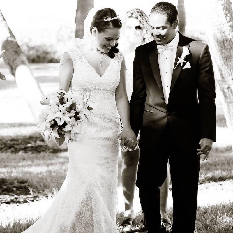 bride and groom holding hands after just getting married on their wedding day