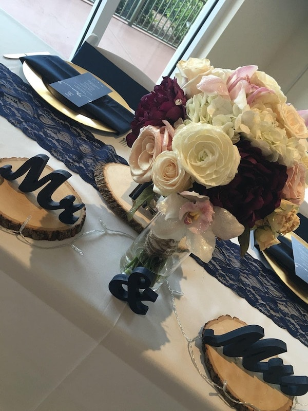 brides wedding bouquet used as centerpiece on sweetheart table at wedding reception
