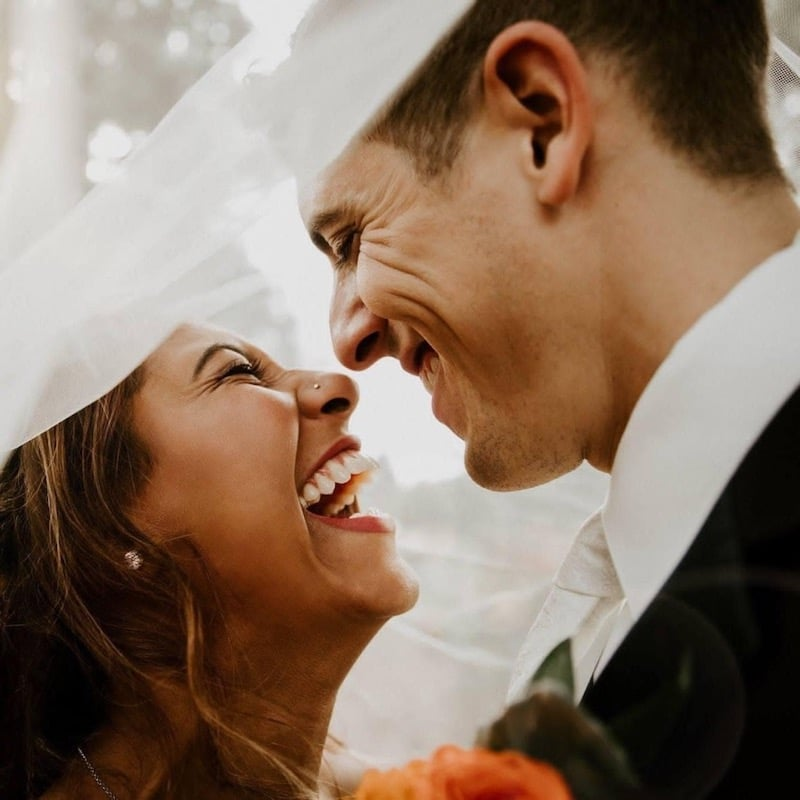 bride and groom laughing after just getting married