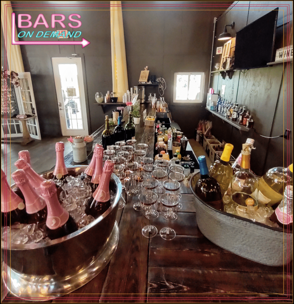 champagne and wine on ice with several glasses ready for guests from Bars on Demand