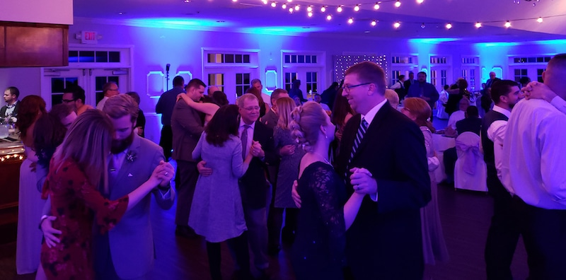 couples slow dancing during wedding reception