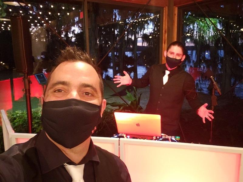 dj's in black wearing black face masks