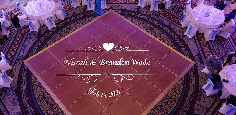 bride and groom's names projected onto the dance floor in the middle of the wedding reception