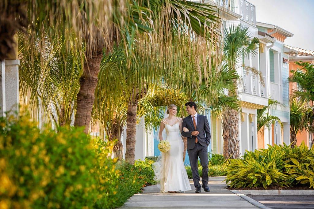 bride groom walking down sidewalk