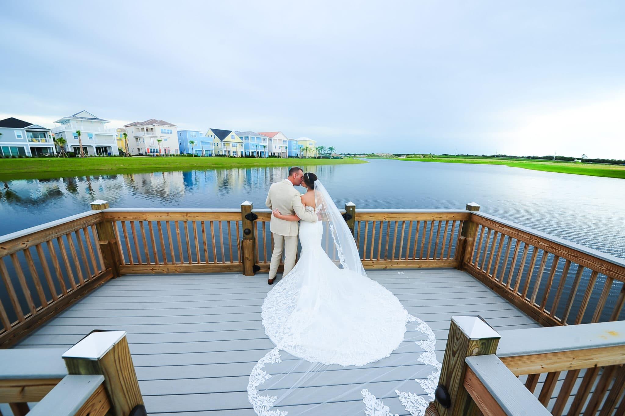 couple standing on deck overlooking water