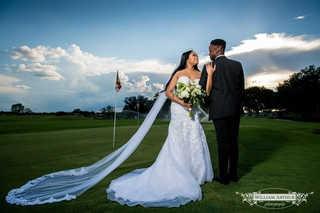 bride & groom on golf course