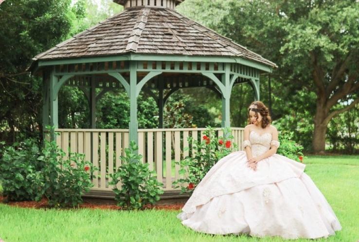 bride in front of gazebo