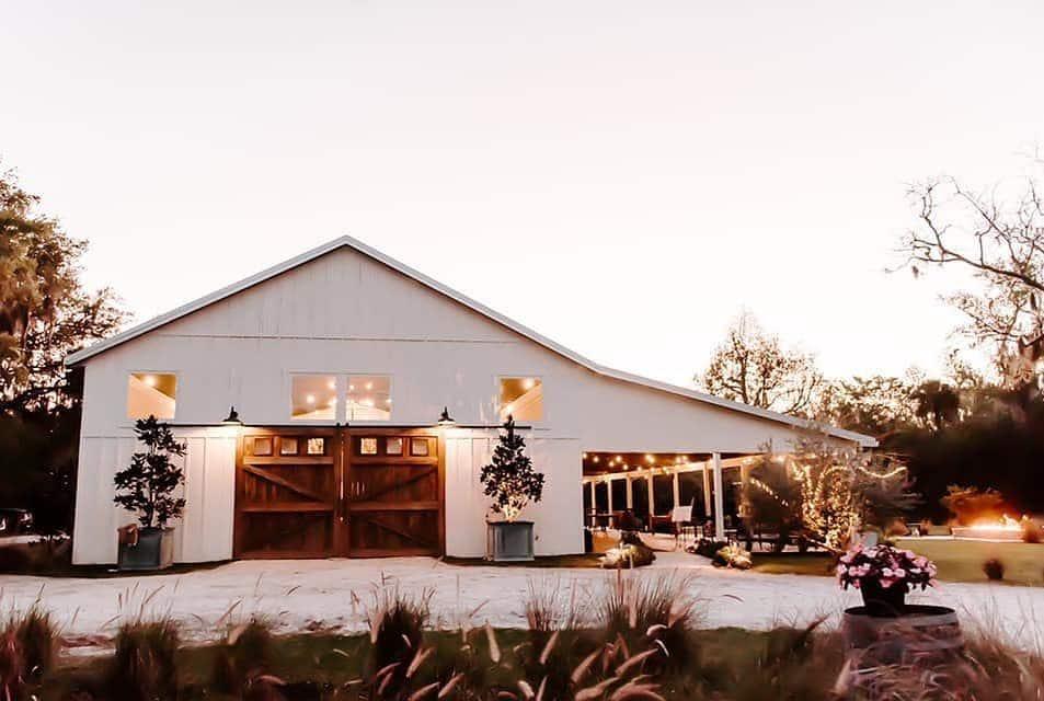 mulberry new smyrna beach white barn wedding venue at sunset