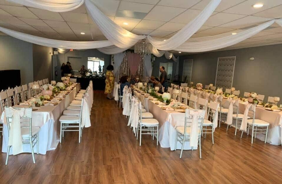 Amore Events Venue tables under sheet ceiling hanging