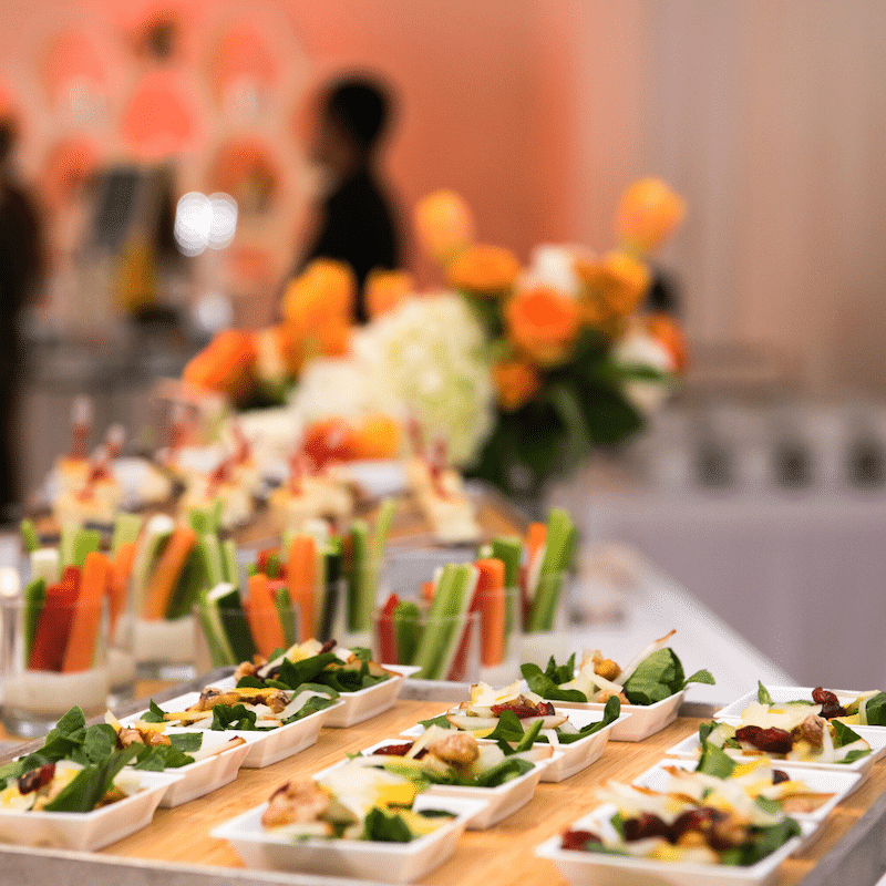 table filled with individual salad bites and vegetable cups