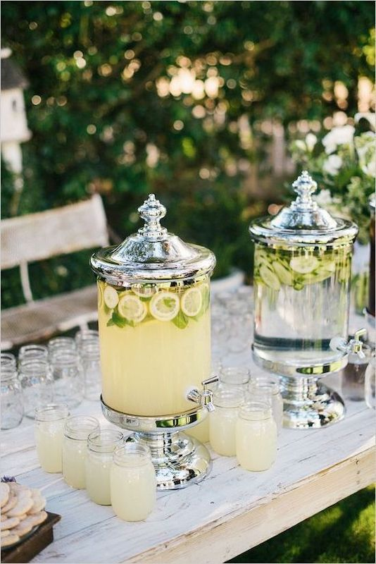 water and lemonade with lemons and limes floating ready to be served at outdoor wedding