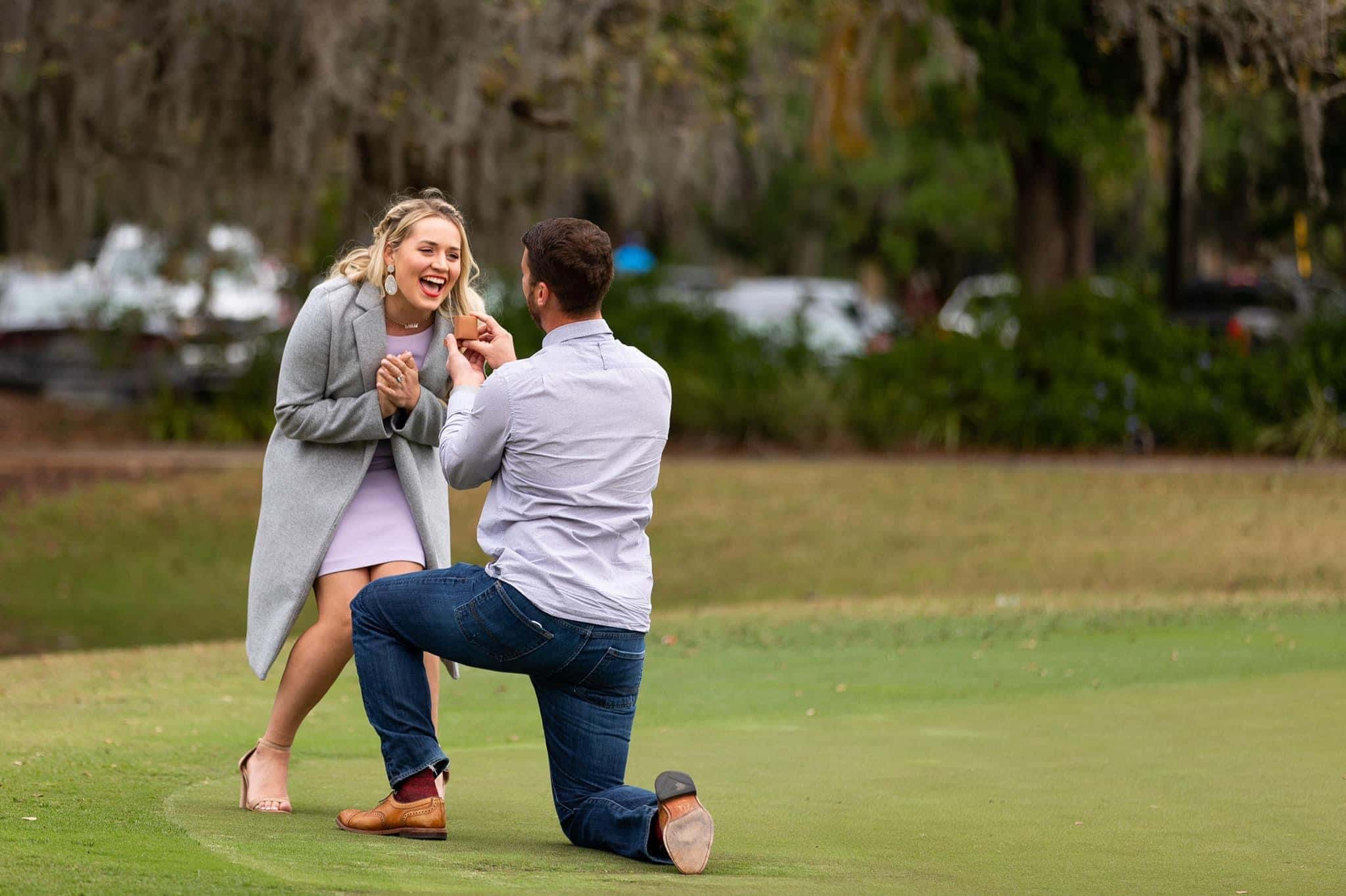 man on one knee proposing to surprised woman at orlando golf course