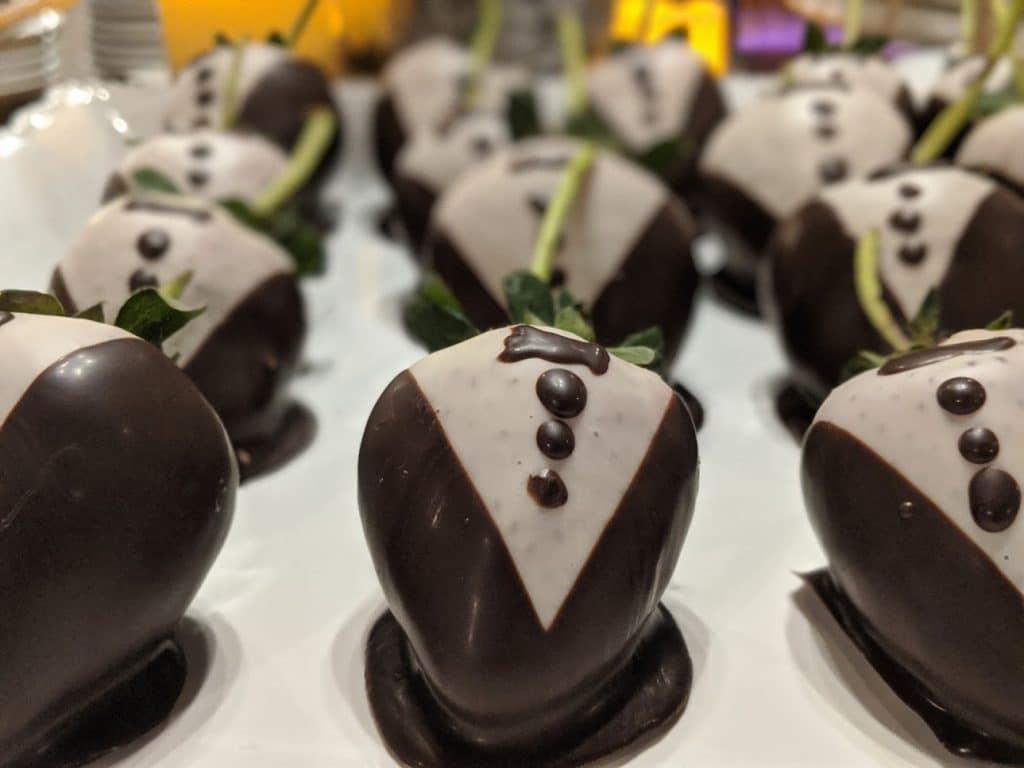 chocolate covered strawberries with white and dark chocolate tuxedo designs