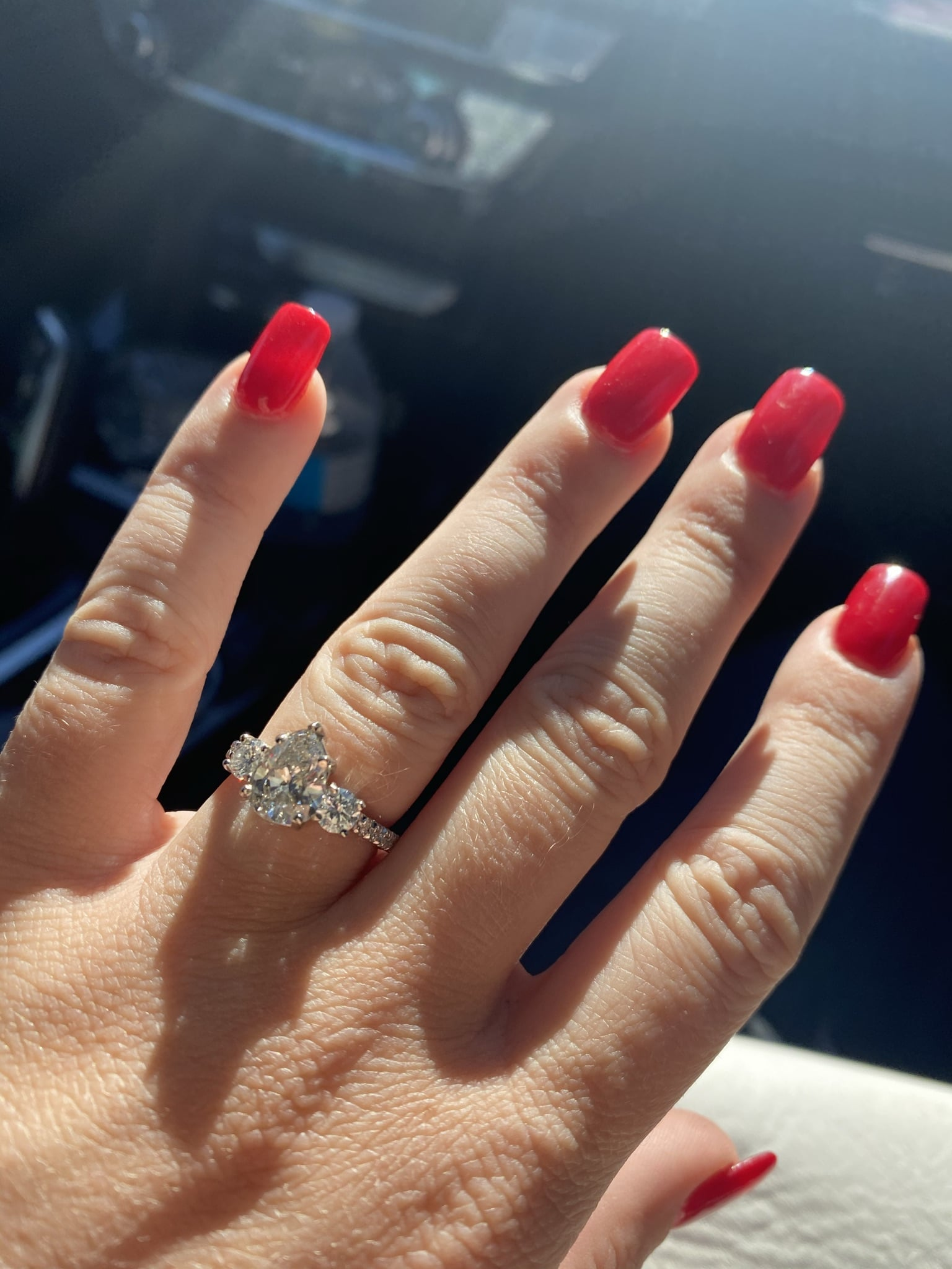 bride to be showing off her new engagement ring