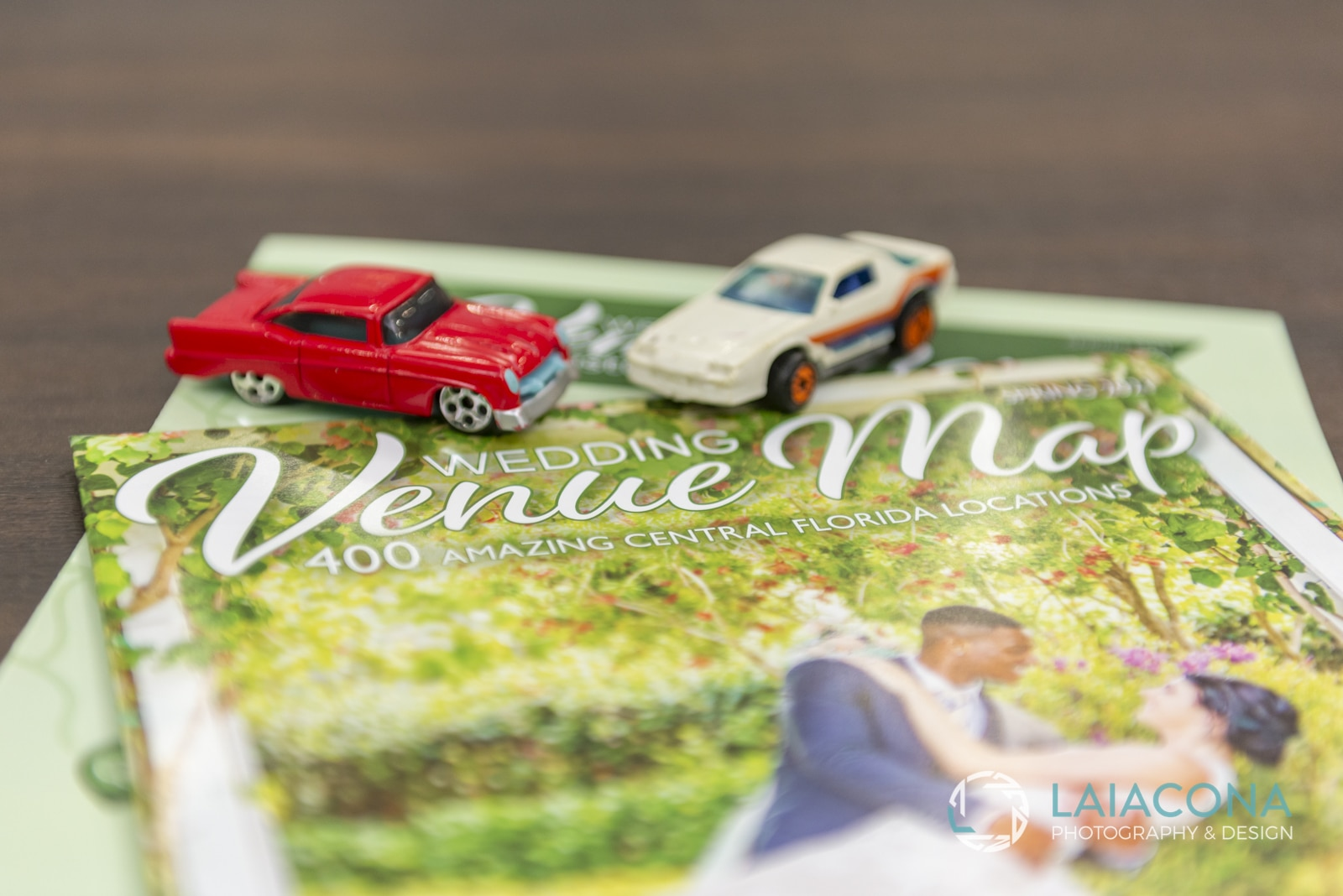 toy cars on top of Wedding Venue Map magazine at the Orlando Wedding Pro Speed Networking event