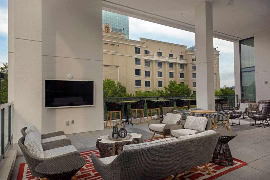 outdoor covered patio in downtown orlando with seating areas and large tv at the university club wedding venue
