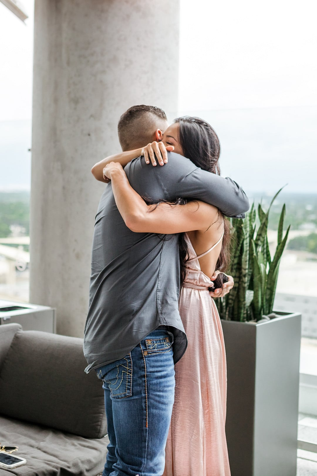 bride and groom to be hugging after aerial marriage proposal