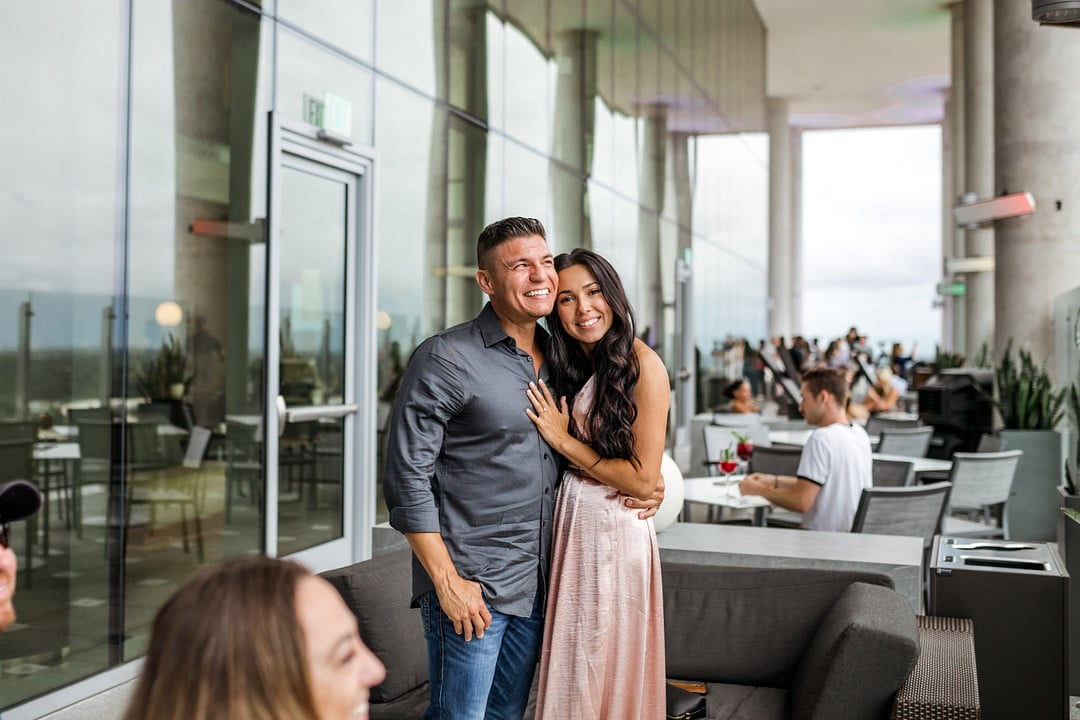 newly engaged couple after the aerial marriage proposal hugging and smiling