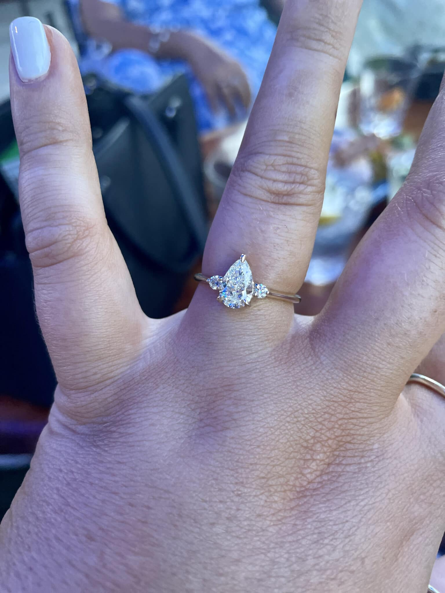 bride to be showing off her left hand with her new engagement ring on her ring finger