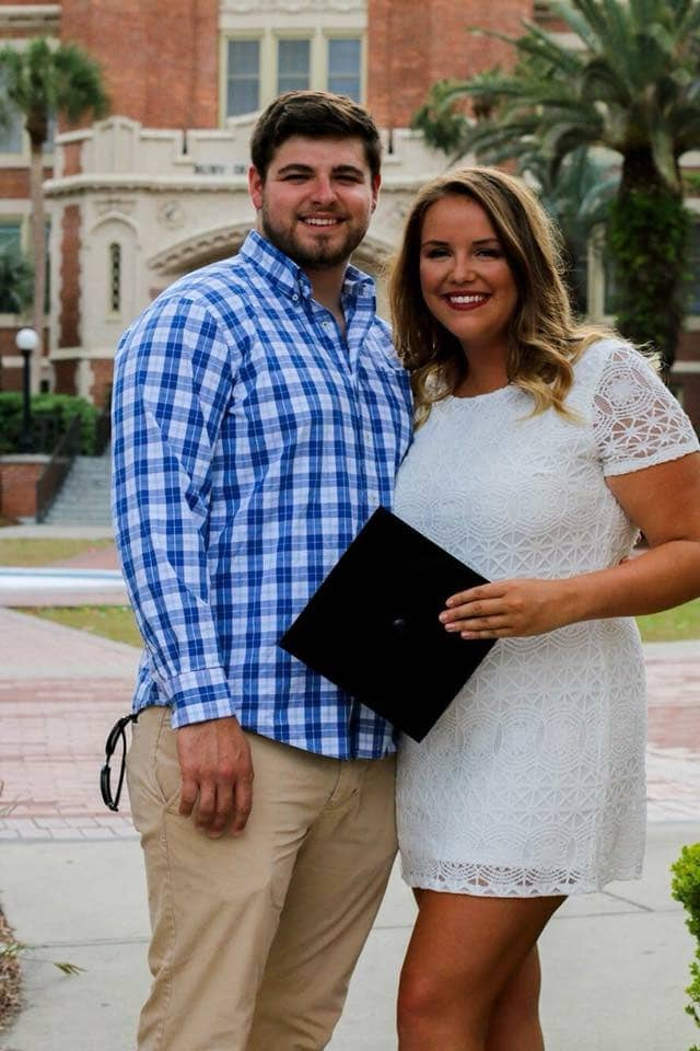 couple standing together at girlfriend's graduation