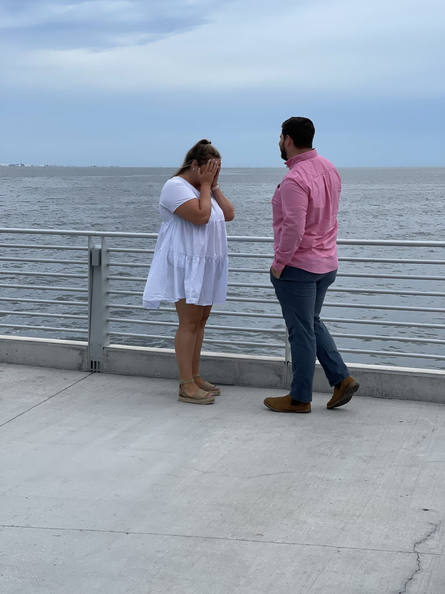 couple standing together just before their st. pete pier marriage proposal