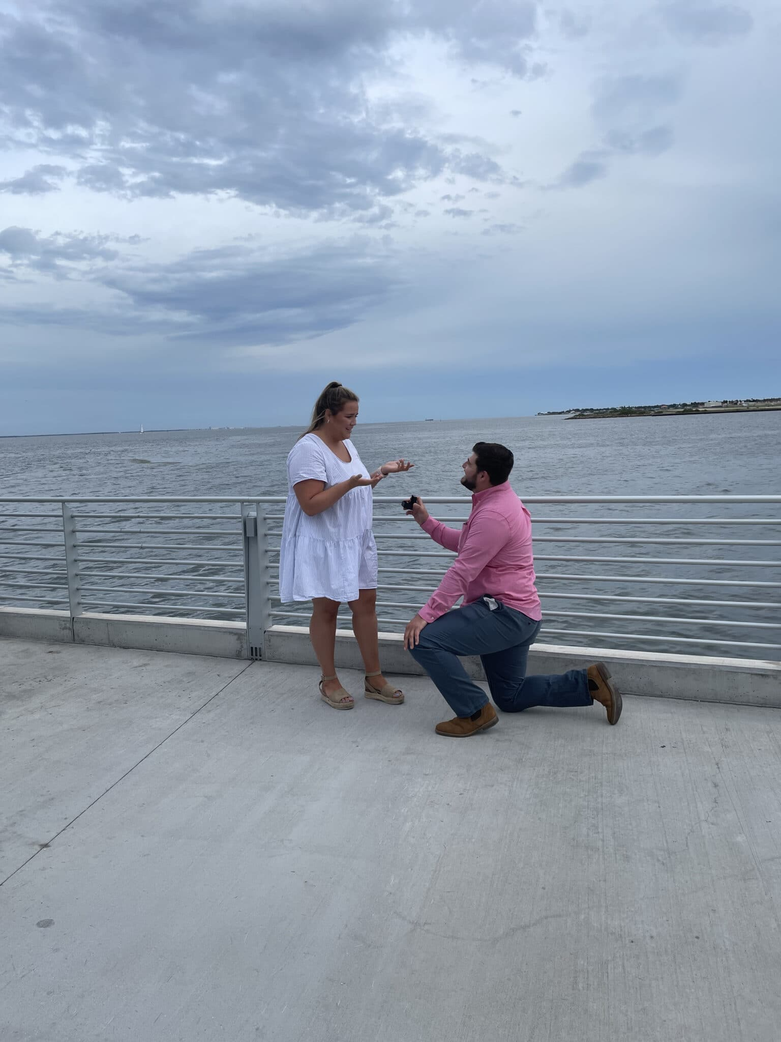 groom to be on one knee proposing to the bride to be at their st. pete pier marriage proposal
