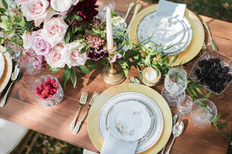 table setup for wedding reception with beautiful plates rented from The Vintage Dish - Timely Tableware