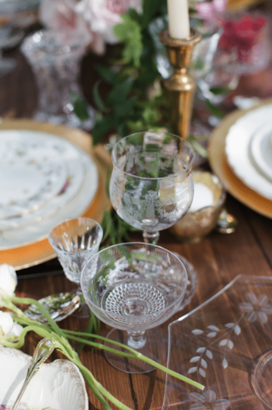 ornate glasses set on table for wedding reception, available to rent from The Vintage Dish - Timely Tableware