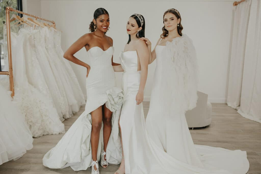three brides in dresses at the bridal finery