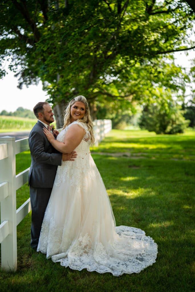 bride looking backwards away from groom
