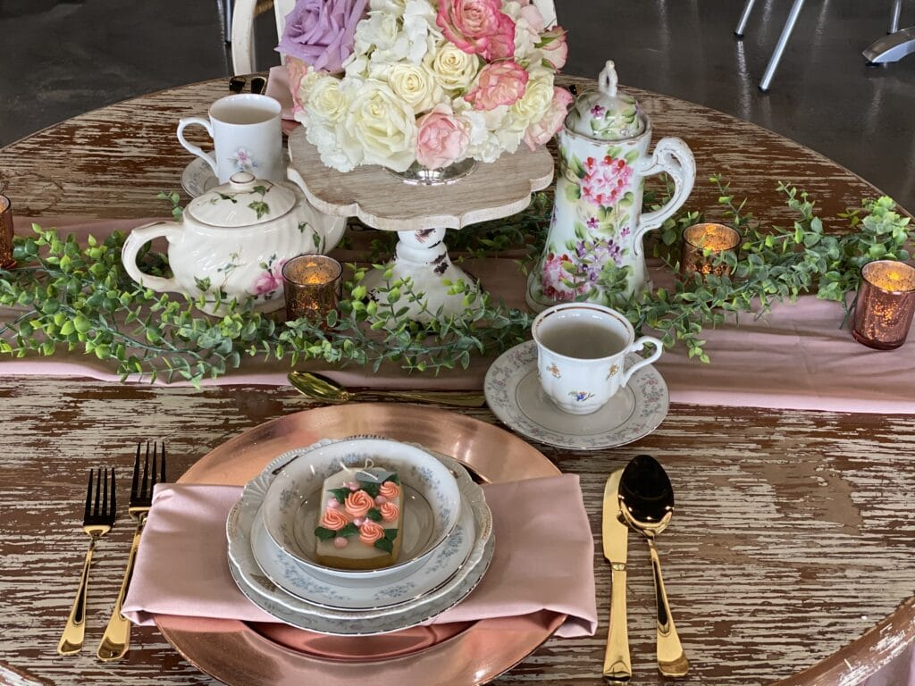 small table decorated with fine china