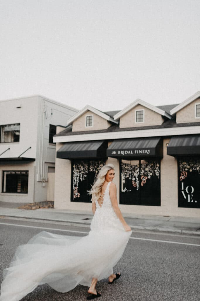 bride in street outside of the bridal finery