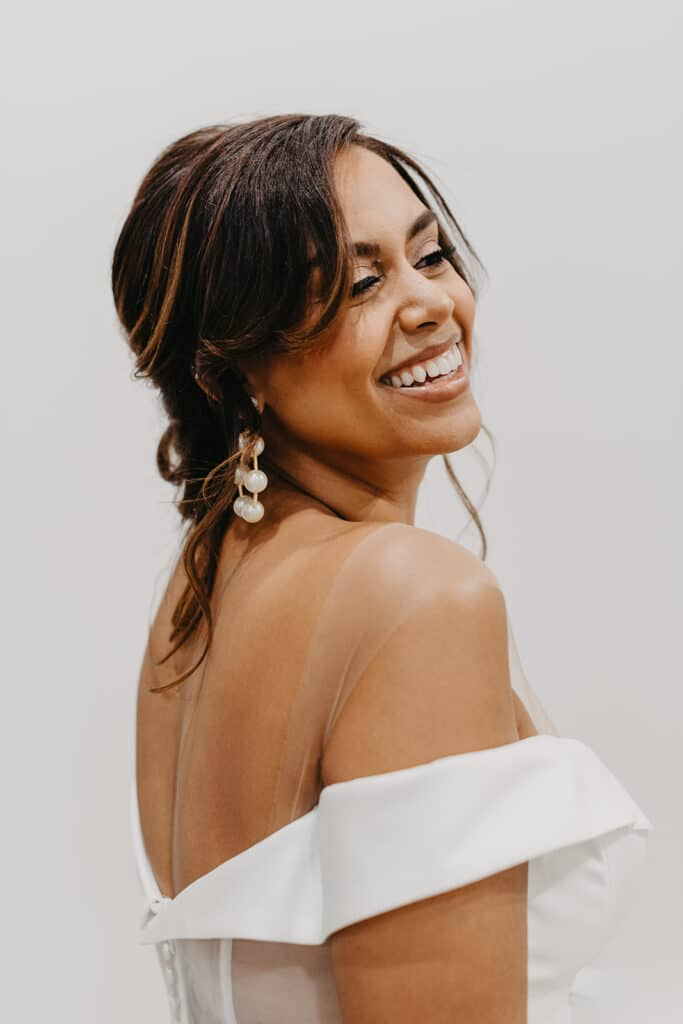bride smiling in off the shoulder dress
