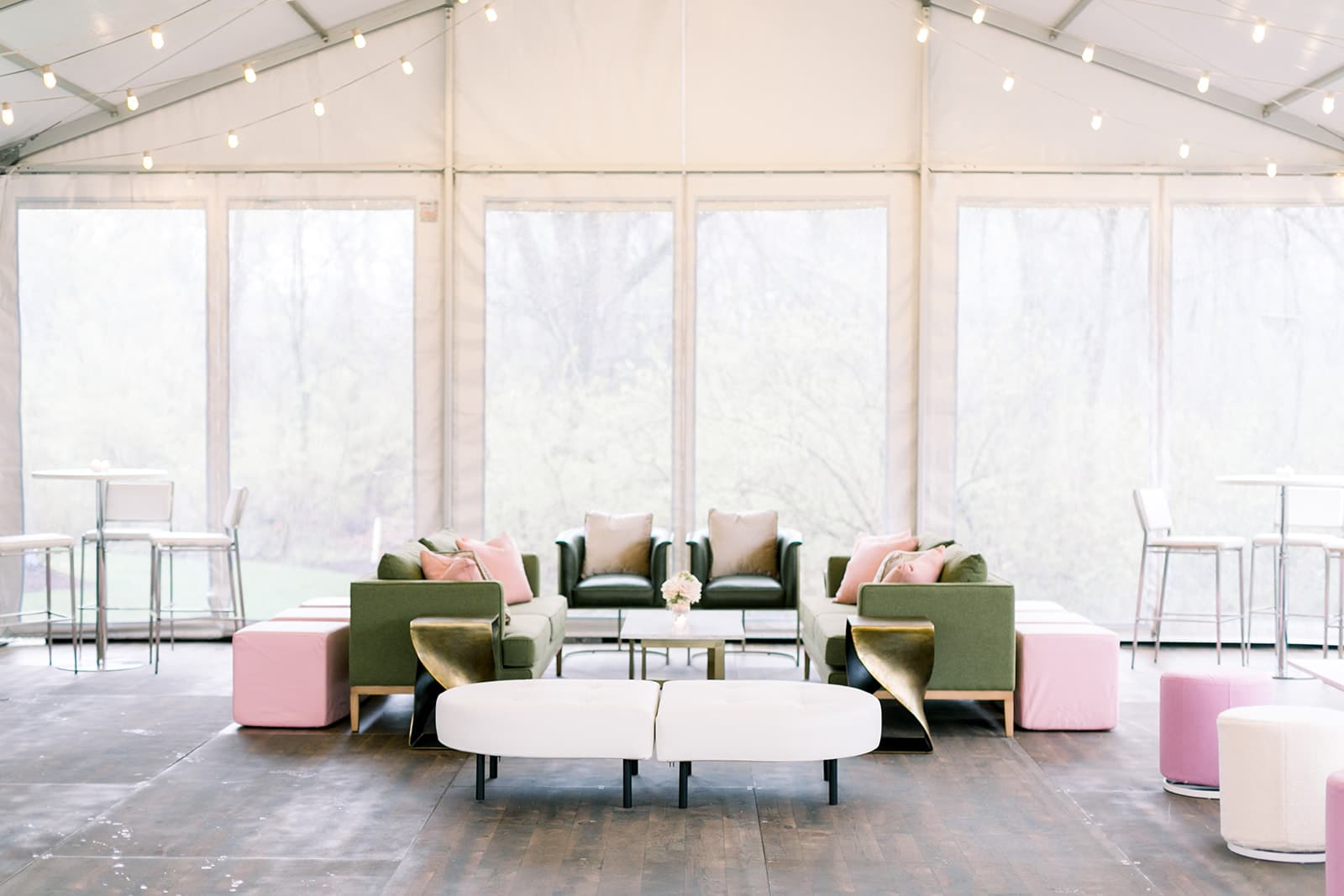 large open room with green, pink, and gold color accents