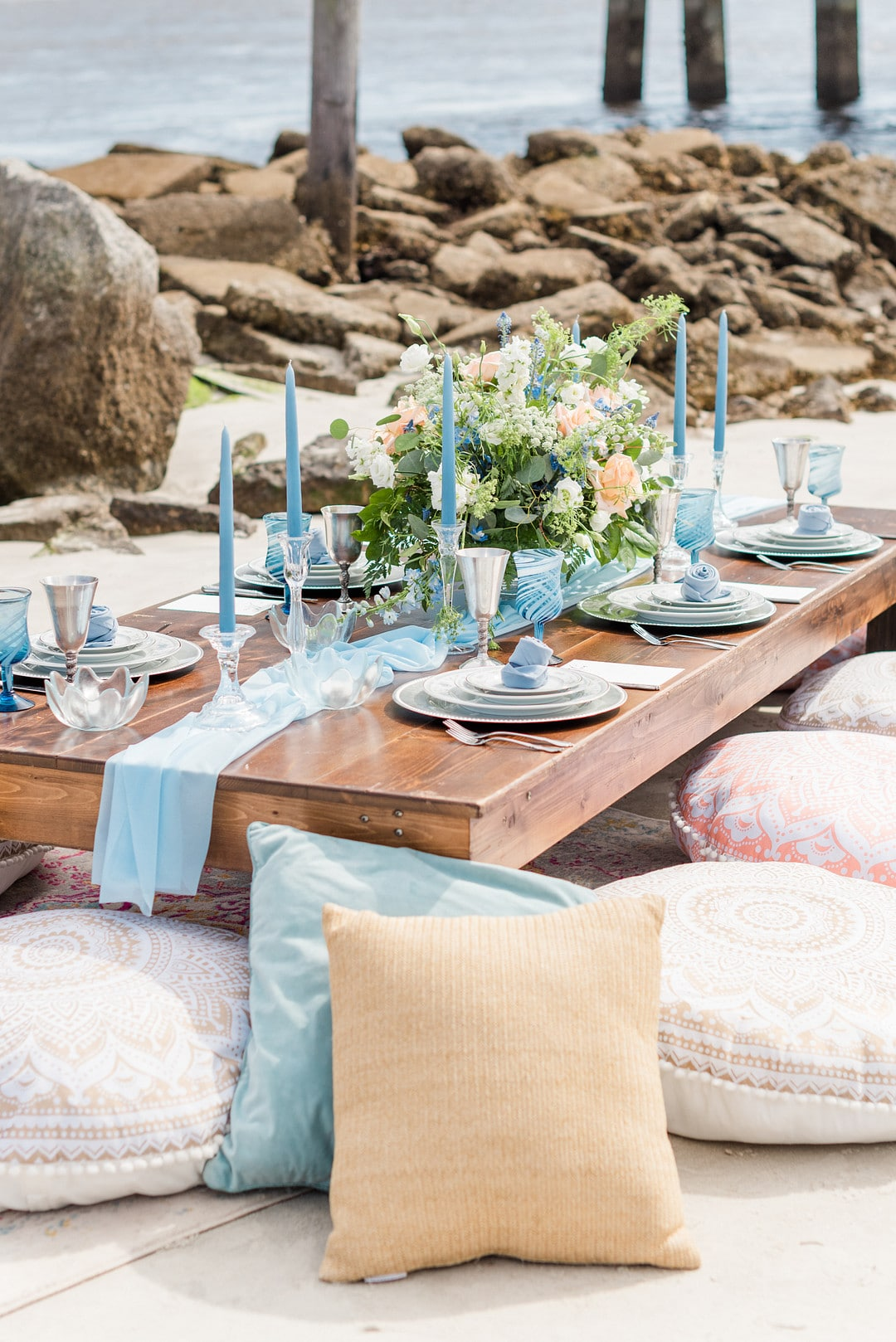 the table set up with pillows surrounding for the amelia island beach wedding inspiration shoot
