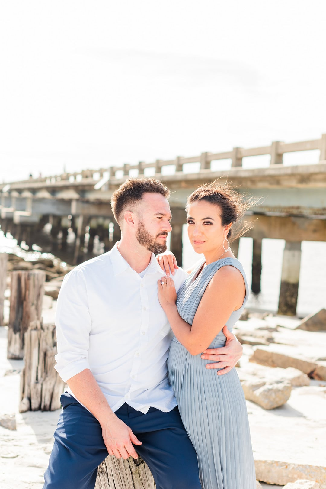 the guests dressed in blue to match the theme of the amelia island beach wedding inspiration shoot
