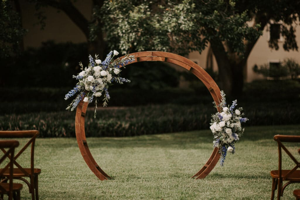 round arch decorated with white and purple flowers from CDC Floral