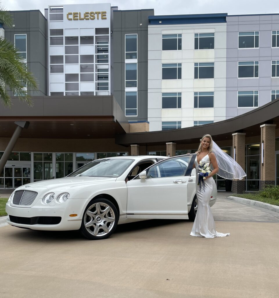 bride getting ready to get into drivers seat of white car