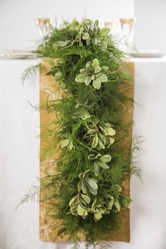 flowers and plants used as decoration on a wedding table