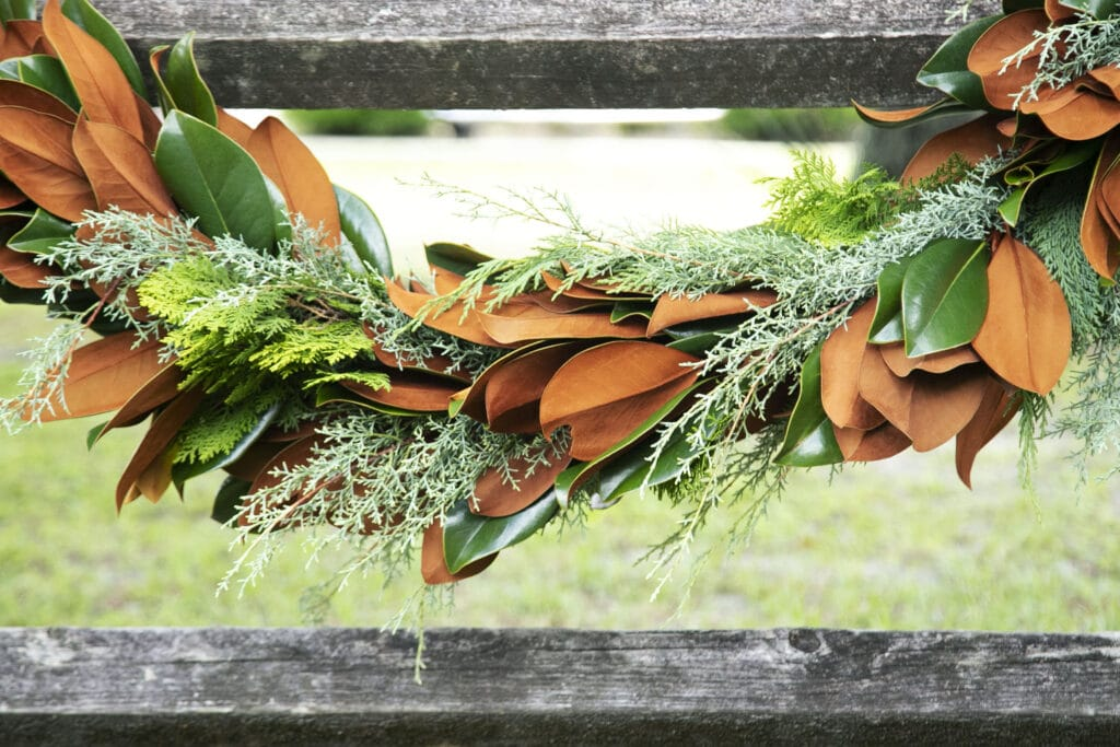 green and brown garland draped across a fence