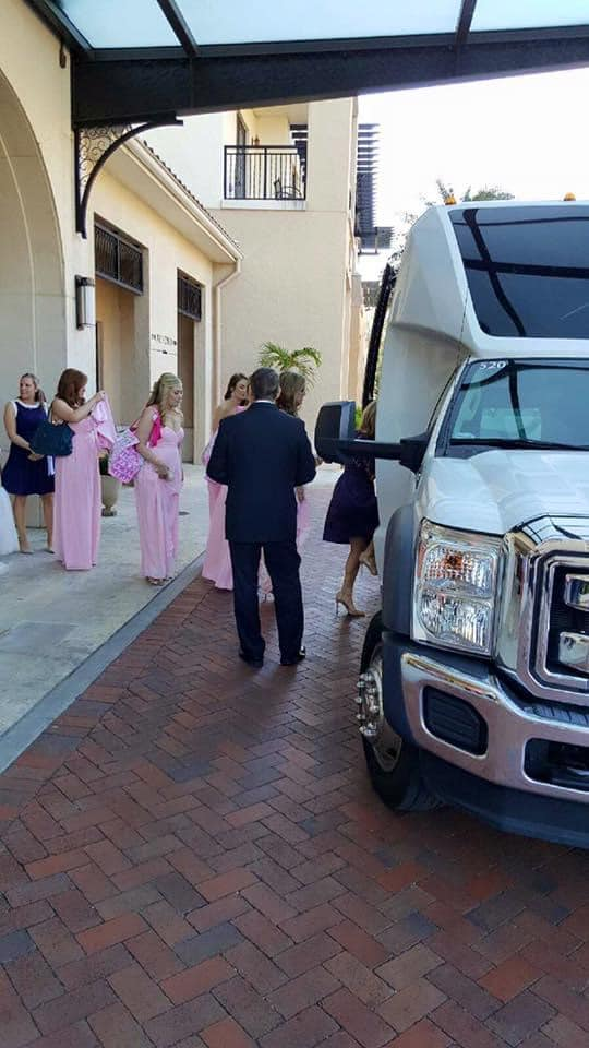 guests boarding a white VIP transportation van to head to wedding