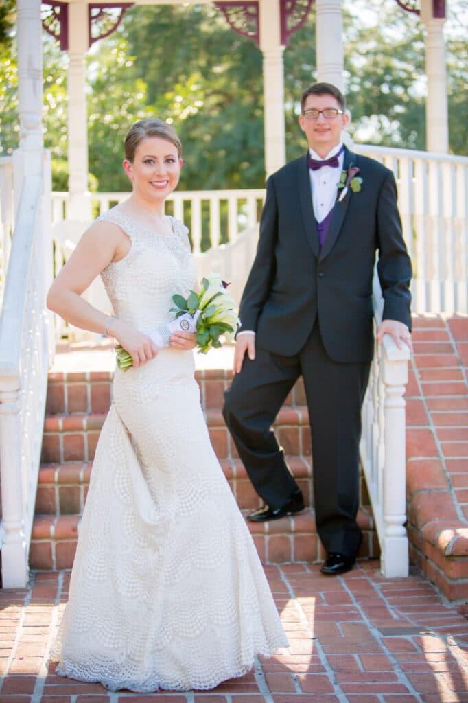 ElizabethLouise Harpist bride and groom on stairs outdoor gazebo