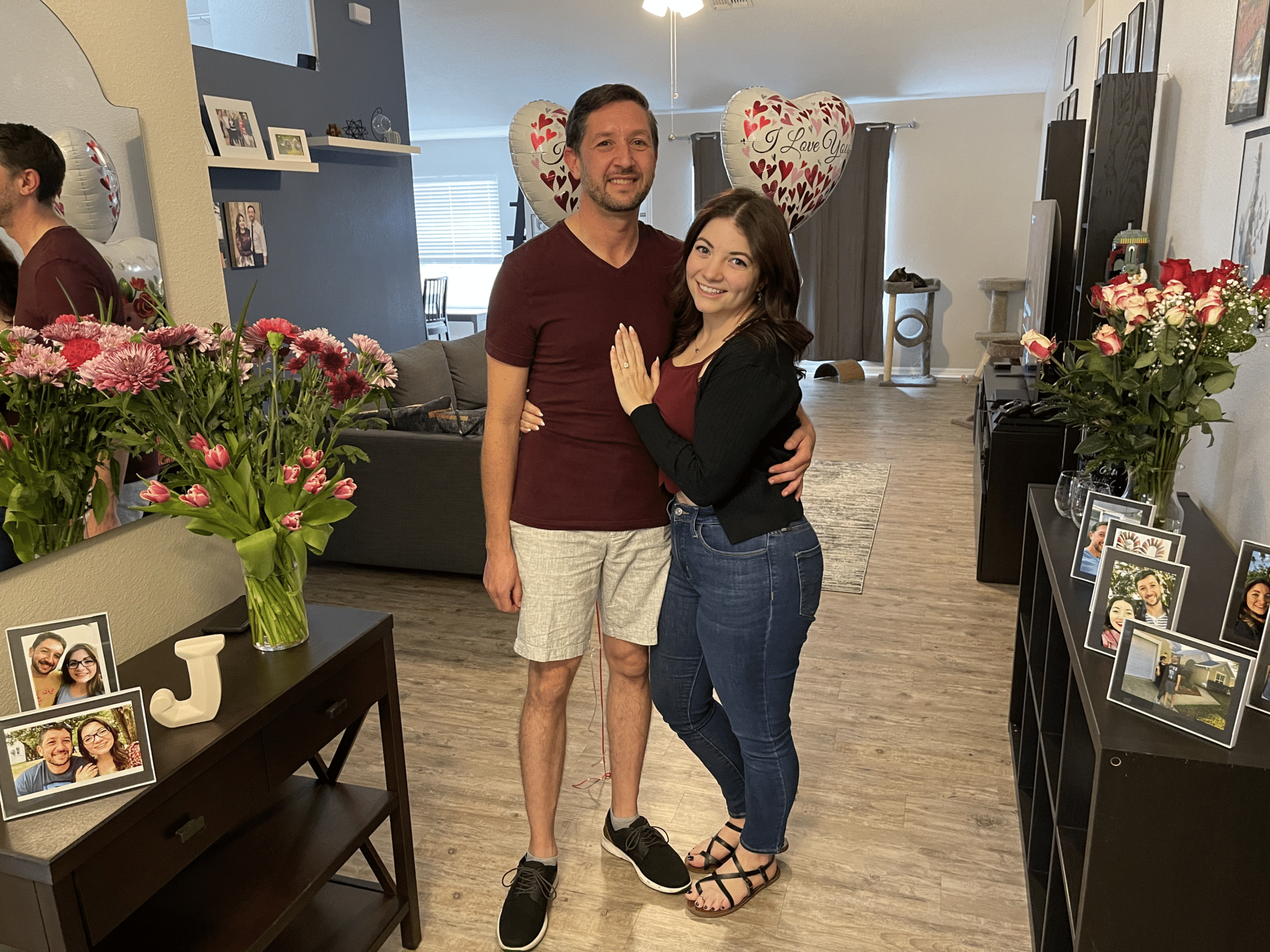 engaged couple posing together and smiling after their central florida at home marriage proposal