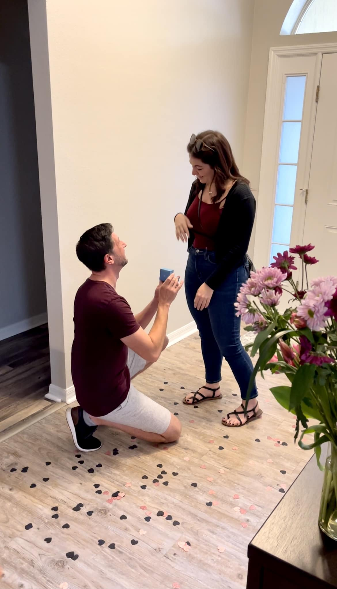 groom to be holding open the ring box for his girlfriend during their central florida at home marriage proposal