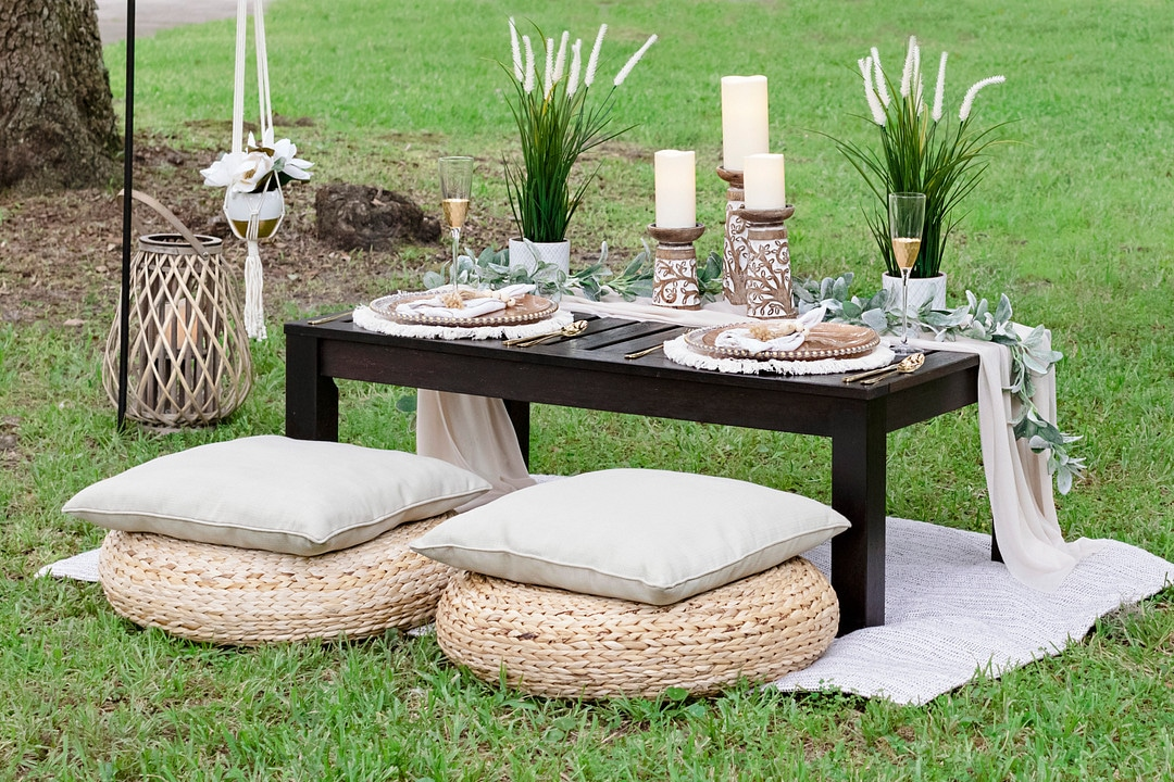 the picnic table set up with two spots for the bride and groom of the picnic wedding inspiration shoot.