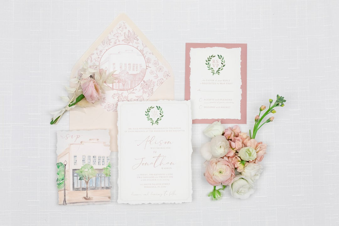 the rsvp cards for the wedding surrounded by pink florals for the picnic wedding inspiration shoot.
