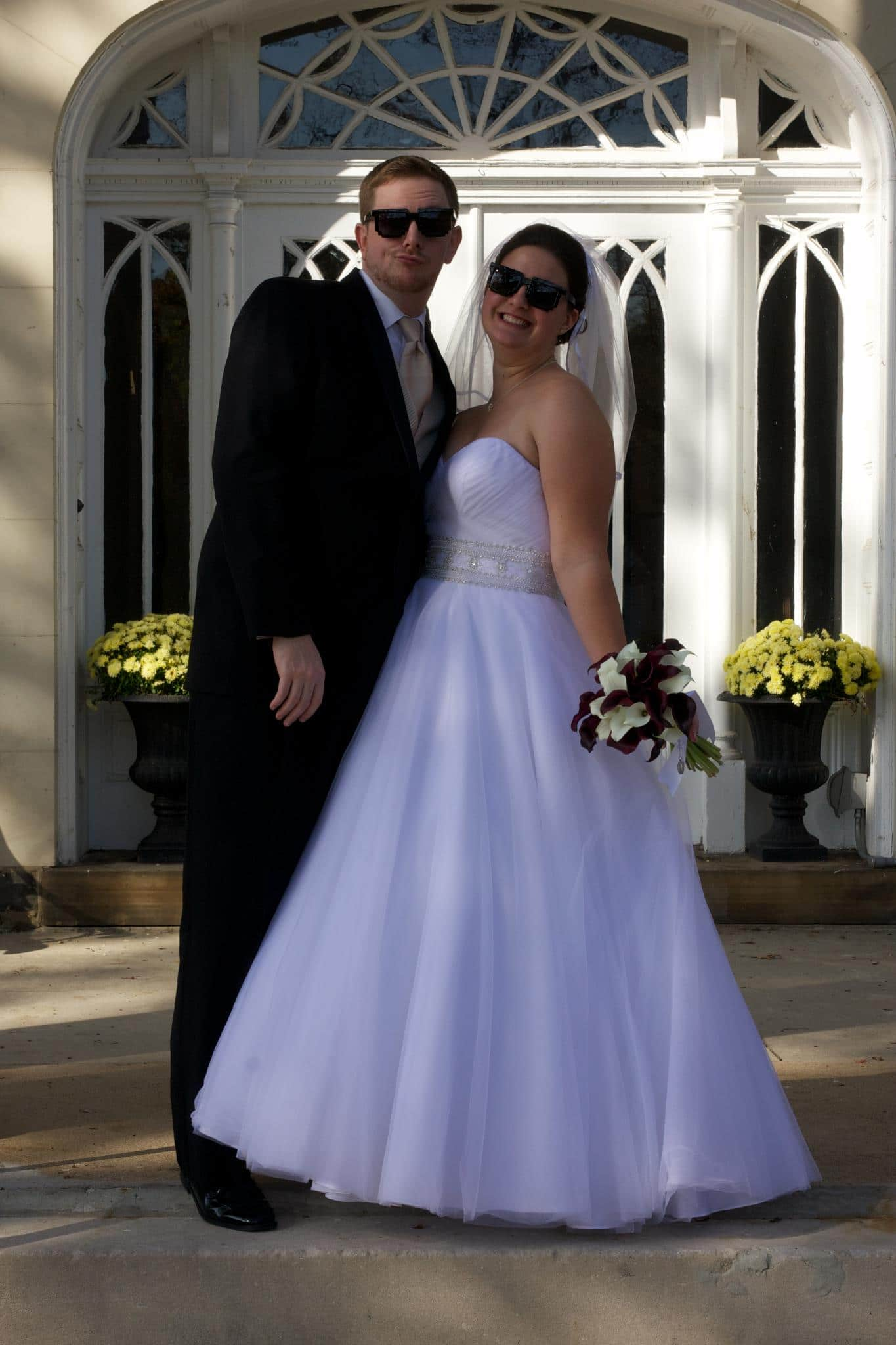 Christine Kirby Bride and groom with sunglasses