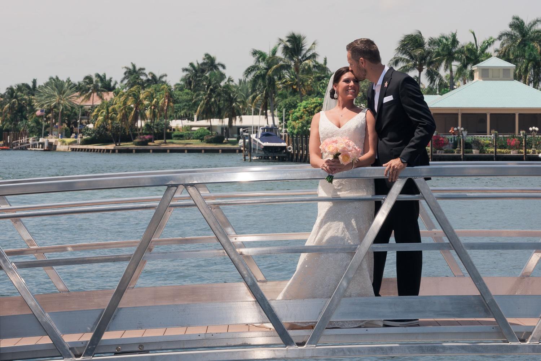 Bride and Groom on bridge on the water
