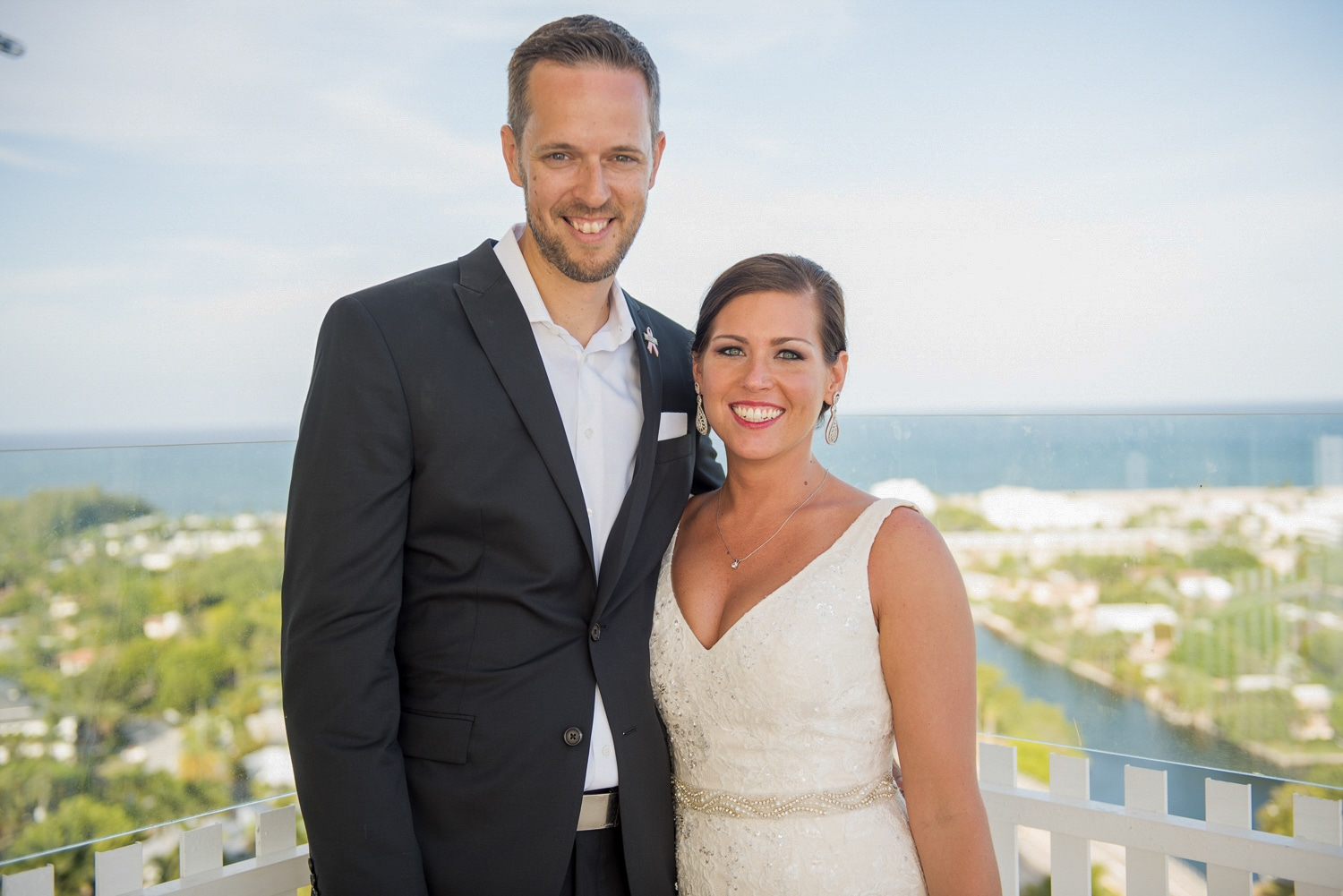 Bride and Groom on balcony with ocean view
